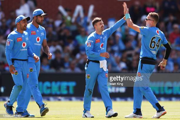 Liam O'Connor of the Strikers celebrates with Peter Siddle after taking the wicket of Ben Cutting of the Heat during the Big Bash League match...