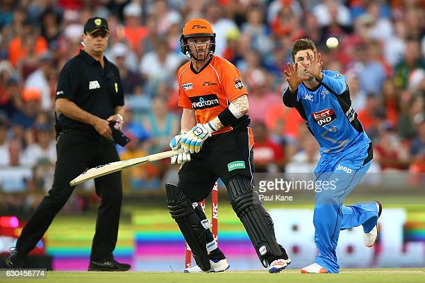 Liam O'Connor of the Strikers fields the ball off his bowling during the Big Bash League between the Perth Scorchers and Adelaide Strikers at WACA on...