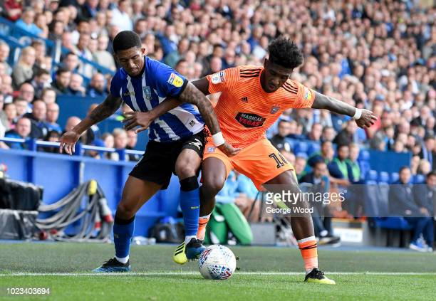 Liam Palmer of Sheffield Wednesday competes for the ball with Ellis Harrison of Ipswich Town during the Sky Bet Championship match between Sheffield...