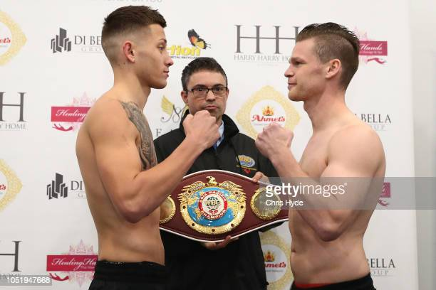 Liam Paro of Australia and Robert Tlatlik of Germany face off during the weigh in at Brisbane Entertainment Centre on October 12 2018 in Brisbane...