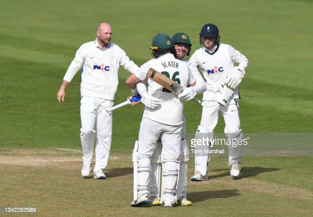 Liam Patterson-White and Ben Slater of Nottinghamshire celebrate their win over Yorkshire during the LV= Insurance County Championship match between...