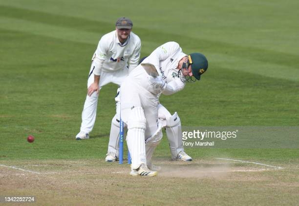 Liam Patterson-White of Nottinghamshire hits a four to win the match during the LV= Insurance County Championship match between Nottinghamshire and...