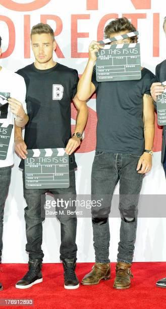 Liam Payne and Harry Styles of One Direction pose a photocall to launch their new film 'One Direction: This Is Us 3D' at Big Sky Studios on August...