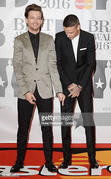 Liam Payne and Louis Tomlinson from One Direction attend the Brit Awards at O2 Arena