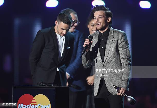 Liam Payne and Louis Tomlinson from One Direction with their British Artist Video of the Year award on stage with Alan Carr at the BRIT Awards 2016...