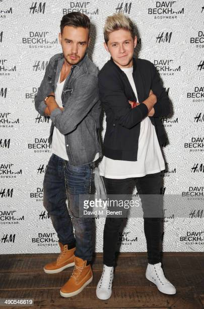 Liam Payne and Niall Horan of One Direction attend the private launch of David Beckham For HM Swimwear at Shoreditch House on May 14 2014 in London...