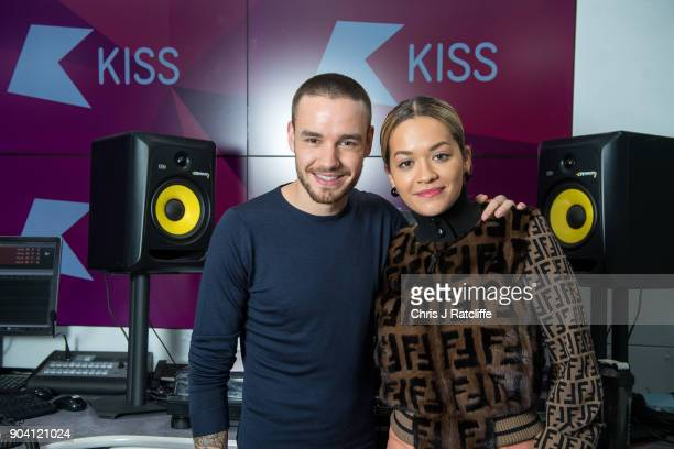 Liam Payne and Rita Ora pose for a photograph as Liam Payne and Rita Ora visit KISS FM at Bauer Radio on January 12 2018 in London England