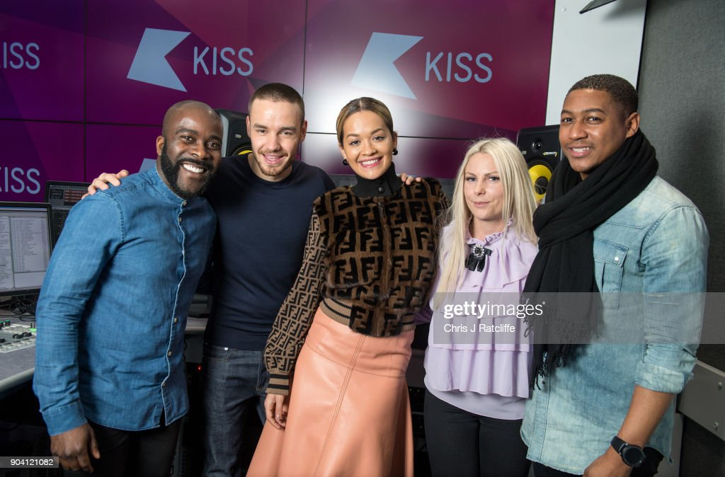 Liam Payne and Rita Ora pose for a photograph with Kiss FM presenters (L-R) Melvin, Charlie and Rickie as Liam Payne and Rita Ora visit KISS FM at Bauer Radio on January 12, 2018 in London, England.