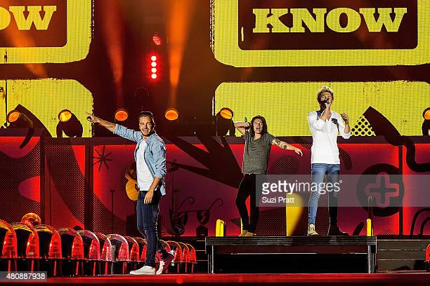 Liam Payne Harry Styles and Niall Horan of One Direction perform at CenturyLink Field on July 15 2015 in Seattle Washington