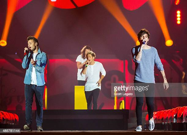 Liam Payne Harry Styles Niall Horan and Louis Tomlinson of One Direction perform in support of the On The Road Again Tour at Ford Field on August 29...