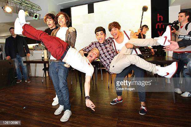 Liam Payne Louis Tomlinson Harry Styles Zain Malik and Niall Horan of One Direction visit Glasgow Manchester and London on September 11 2011 The tour...