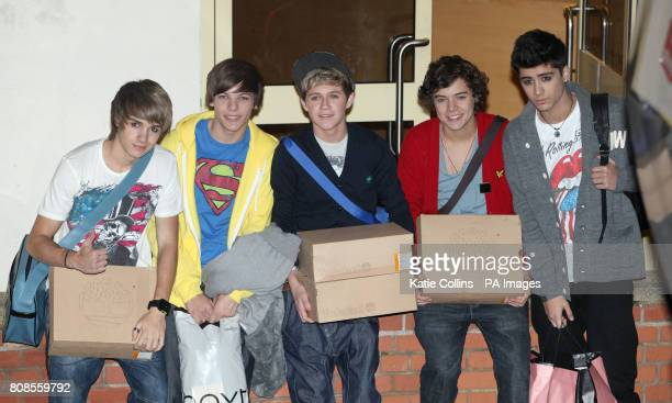 Liam Payne Louis Tomlinson Niall Horan Harry Styles and Zayn Malik of One Direction leave after this week's X Factor result show at the Fountain...
