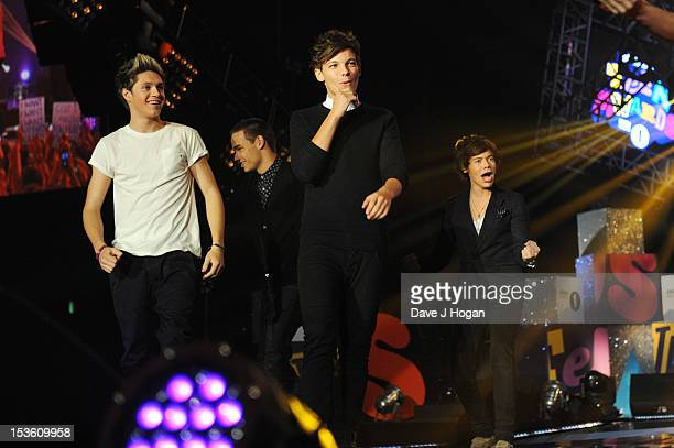 Liam Payne Louis Tomlinson Niall Horan Zayn Malik and Harry Styles of One Direction accept an award onstage at the BBC Radio 1 Teen Awards 2012 at...