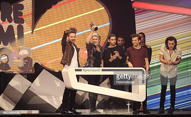 Liam Payne Niall Horan Zayn Malik Louis Tomlinson and Harry Styles of One Direction receives a '40 Principales Award' at the Palacio de los Deportes...