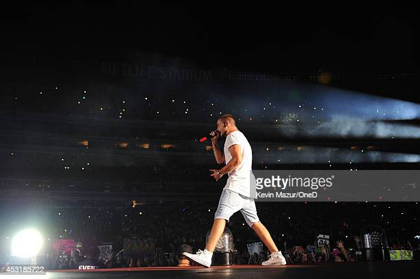 Liam Payne of One Direction performs onstage during the Where We Are tour at Met Life Stadium on August 4 2014 in New York City