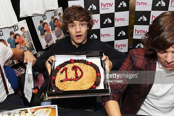 Liam Payne of One Direction shows a cake while visiting Glasgow Manchester and London on September 11 2011 The tour was taken in a luxury helicopter...