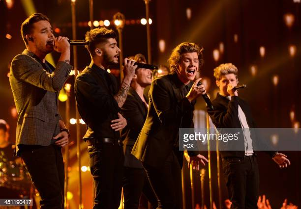 """Liam Payne, Zayn Malik, Harry Styles, Louis Tomlinson and Niall Horan of 'One Direction' performs on FOX's """"The X Factor"""" Season 3 Top 10 To 9 Live..."""