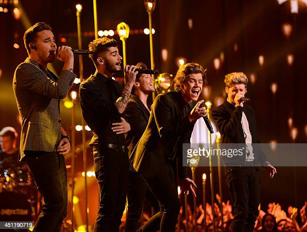Liam Payne Zayn Malik Louis Tomlinson Harry Styles and Niall Horan of 'One Direction' perform on FOX's The X Factor Season 3 Top 10 To 9 Live...