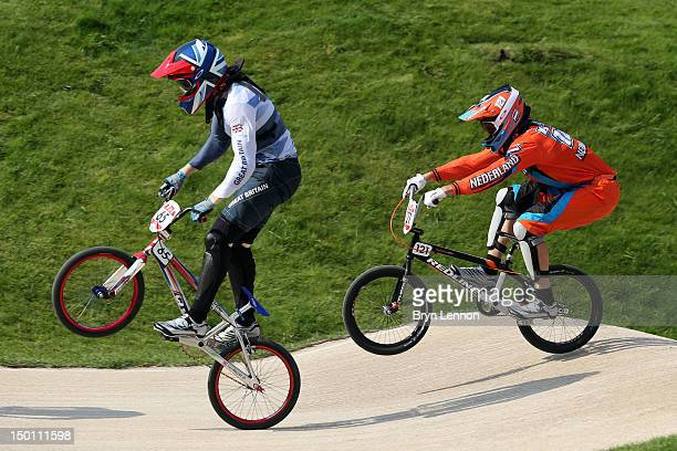 Liam Phillips of Great Britain and Raymon Van Der Biezen of Netherlands compete in the Men's BMX Cycling Semi Finals on Day 14 of the London 2012...
