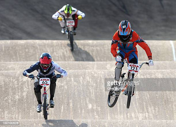 Liam Phillips of Great Britain and Raymon van der Biezen of the Netherlands in action during the Men's BMX Cycling Quarter finals on Day 14 of the...