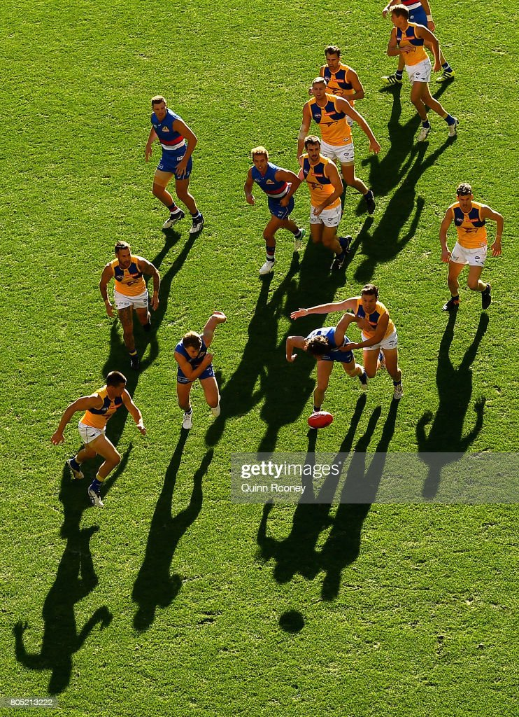 Liam Picken of the Bulldogs and Sam Butler of the Eagles compete for the ball during the round 15 AFL match between the Western Bulldogs and the West Coast Eagles at Etihad Stadium on July 1, 2017 in Melbourne, Australia.