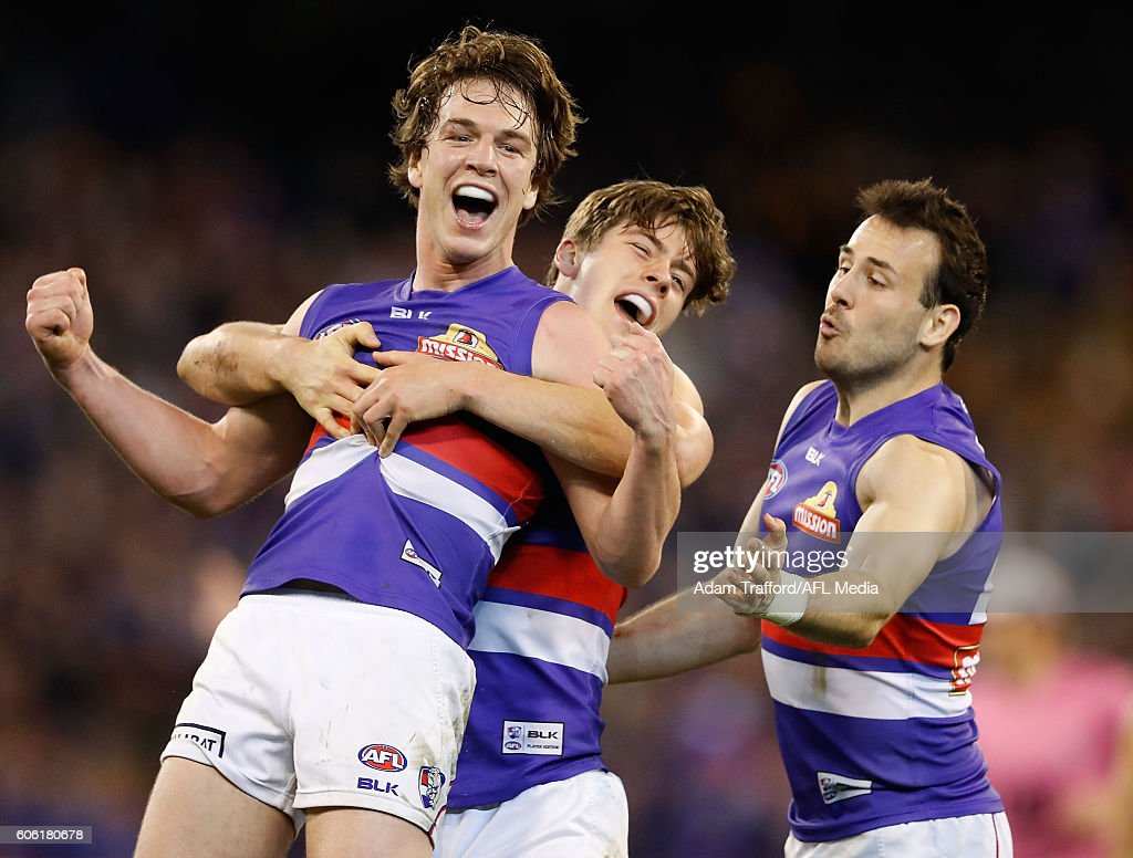Liam Picken of the Bulldogs celebrates a goal with teammates during the 2016 AFL Second Semi Final match between the Hawthorn Hawks and the Western Bulldogs at the Melbourne Cricket Ground on September 16, 2016 in Melbourne, Australia.