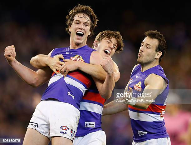 Liam Picken of the Bulldogs celebrates a goal with teammates during the 2016 AFL Second Semi Final match between the Hawthorn Hawks and the Western...