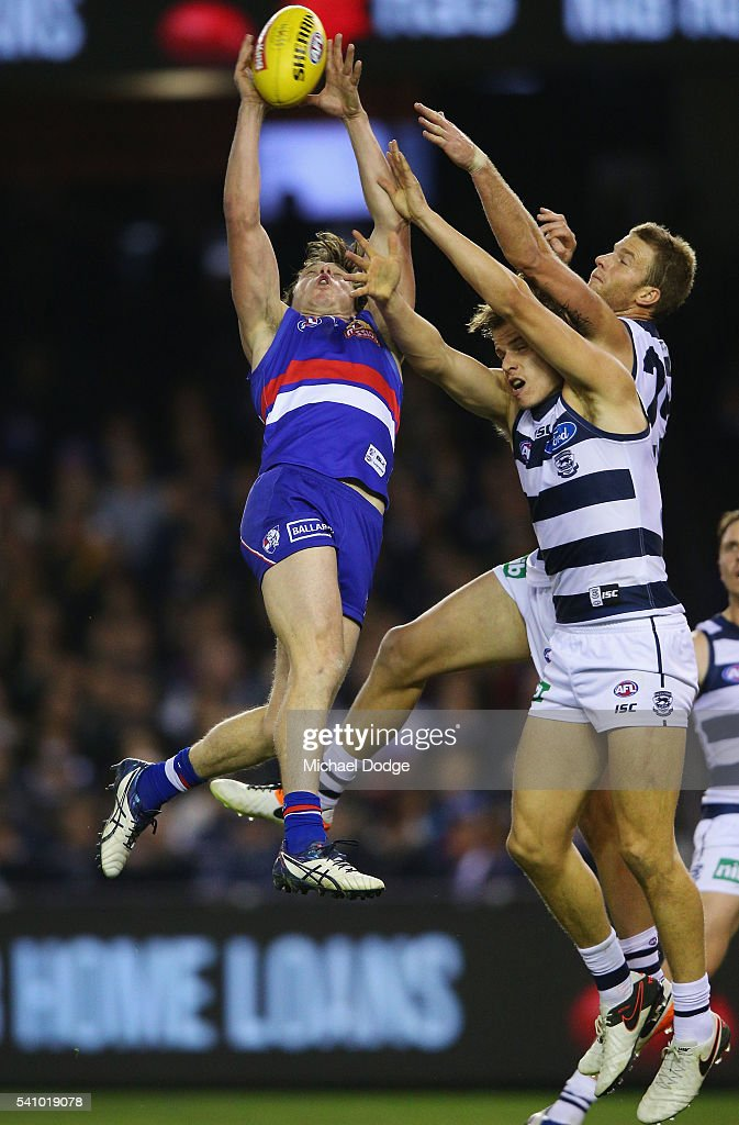 Liam Picken of the Bulldogs (L) compete for the ball against Lachie Henderson of the Cats (R) during the round 13 AFL match between the Western Bulldogs and the Geelong Cats at Etihad Stadium on June 18, 2016 in Melbourne, Australia.