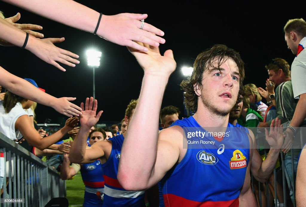Liam Picken of the Bulldogs high fives fans after winning the round 18 AFL match between the Western Bulldogs and the Gold Coast Suns at Cazaly's Stadium on July 22, 2017 in Cairns, Australia.