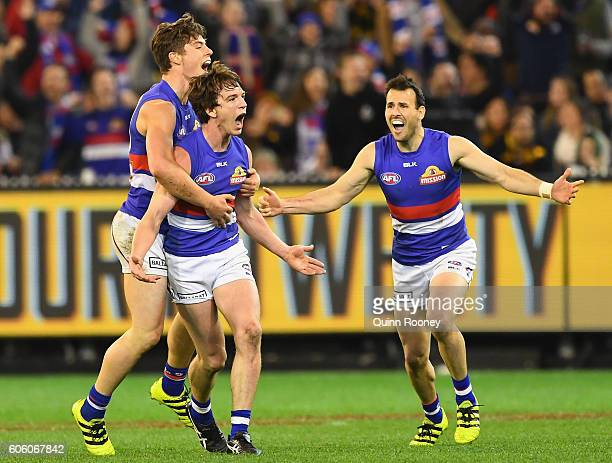 Liam Picken of the Bulldogs is congratulated by Josh Dunkley and Tory Dickson of the Bulldogs after kicking a goal during the second AFL semi final...