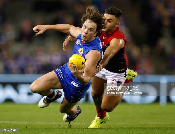 Liam Picken of the Bulldogs is tackled by Christian Salem of the Demons during the 2017 AFL round 13 match between the Western Bulldogs and the...