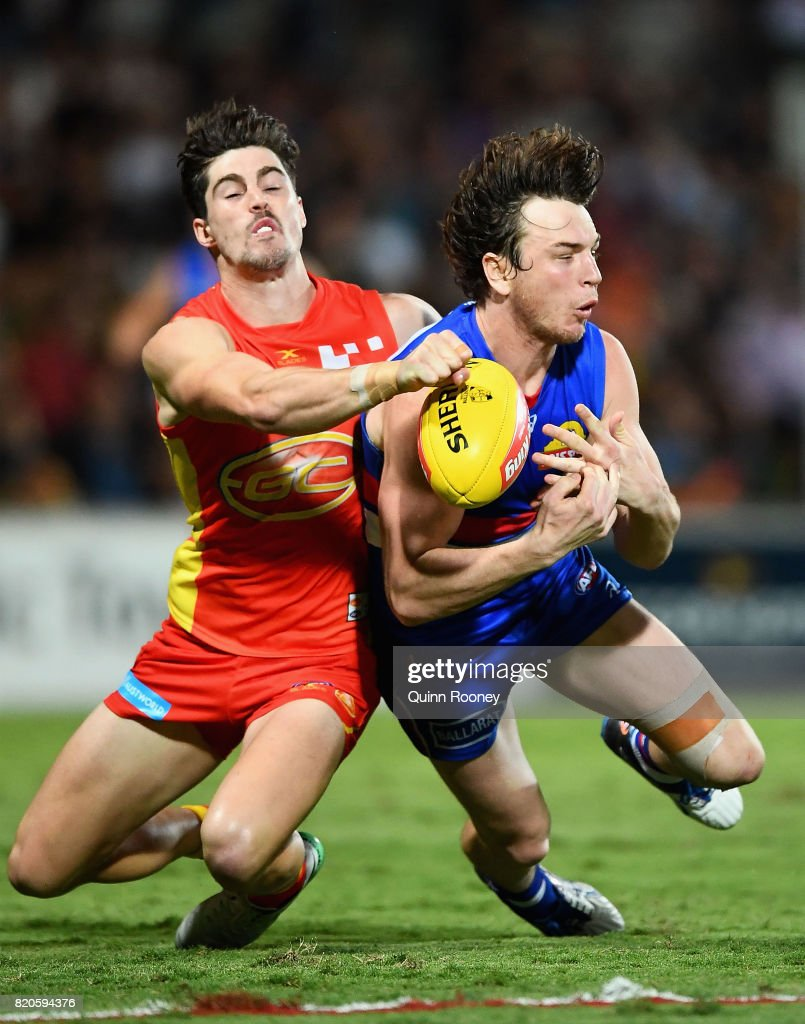 Liam Picken of the Bulldogs marks infront of Alex Sexton of the Suns during the round 18 AFL match between the Western Bulldogs and the Gold Coast Titans at Cazaly's Stadium on July 22, 2017 in Cairns, Australia.
