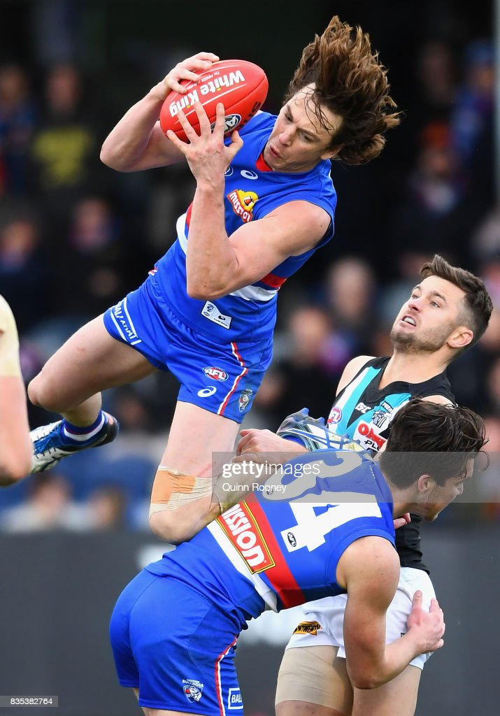 Liam Picken of the Bulldogs marks over the top of Bailey Williams of the Bulldogs and Sam Gray of the Power during the round 22 AFL match between the Western Bulldogs and the Port Adelaide Power at Mars Stadium on August 19, 2017 in Melbourne, Australia.