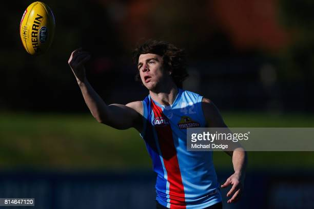 Liam Picken of the Bulldogs marks the ball during a Western Bulldogs AFL training session at Whitten Oval on July 15 2017 in Melbourne Australia