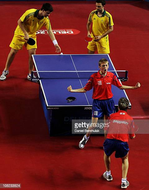 Liam Pitchford celebrates as he turns to team mate Andrew Baggaley of England after defeating William Henzel and Robert Frank of Australia in the...