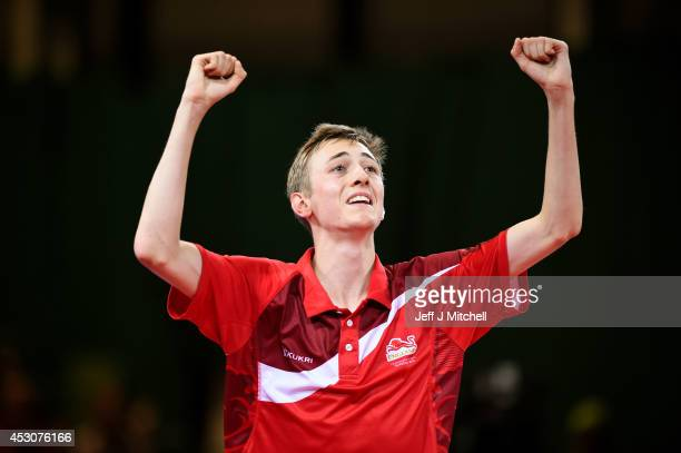 Liam Pitchford of England celebrates winning against Sharath Kamal Achanta of India in the Men's Singles Bronze Medal Match at Scotstoun Sports...
