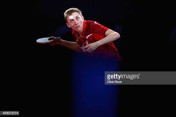 Liam Pitchford of England competes in the Men's Table Tennis singles Quarter Finals match against Soumyajit Ghosh of India at Scotstoun Sports Campus...