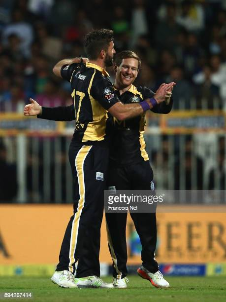 Liam Plunkett and Eoin Morgan of Kerela Kings celebrate during the T10 League Final match between Kerela Kings and Punjabi Legends at Sharjah Cricket...