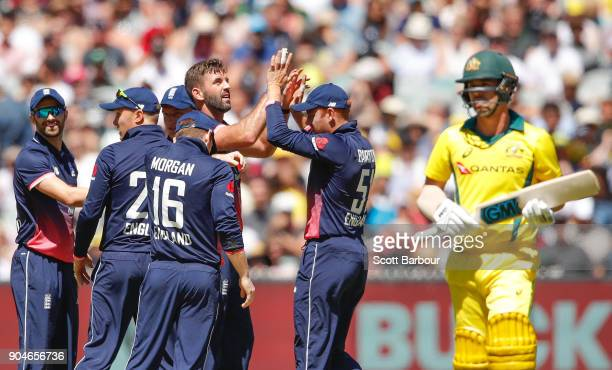 Liam Plunkett of England celebrates after dismissing Travis Head of Australia during game one of the One Day International Series between Australia...