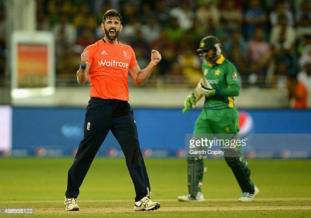 Liam Plunkett of England celebrates dismissing Shoaib Malik of Pakistan during the 2nd International T20 between Pakistan and England at Dubai...