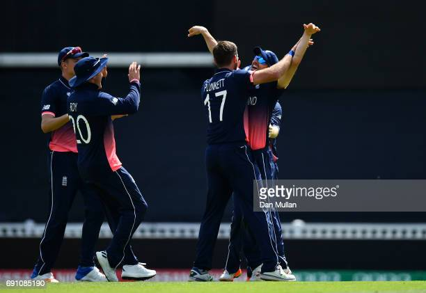 Liam Plunkett of England celebrates taking the wicket of Imrul Kayes of Bangladesh with Mark Wood of England during the ICC Champions Trophy Group A...