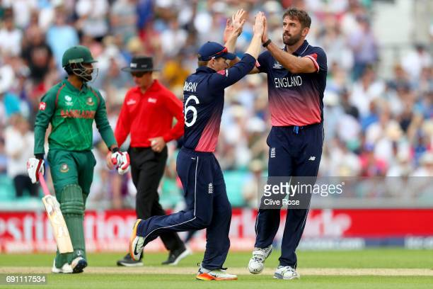 Liam Plunkett of England celebrates the wicket of Tamim Iqbal of Bangladesh during the ICC Champions trophy cricket match between England and...