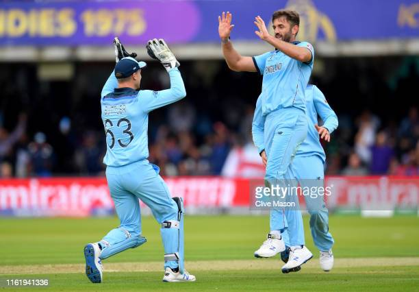 Liam Plunkett of England celebrates with Jos Buttler after dismissing Henry Nicholls of New Zealand during the Final of the ICC Cricket World Cup...