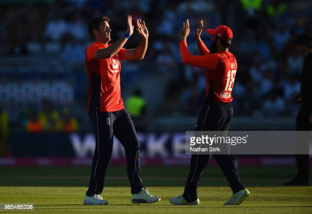 Liam Plunkett of England celebrates with Moeen Ali as he gets D'Arcy Short of Australia out during the 1st Vitality International T20 match between...