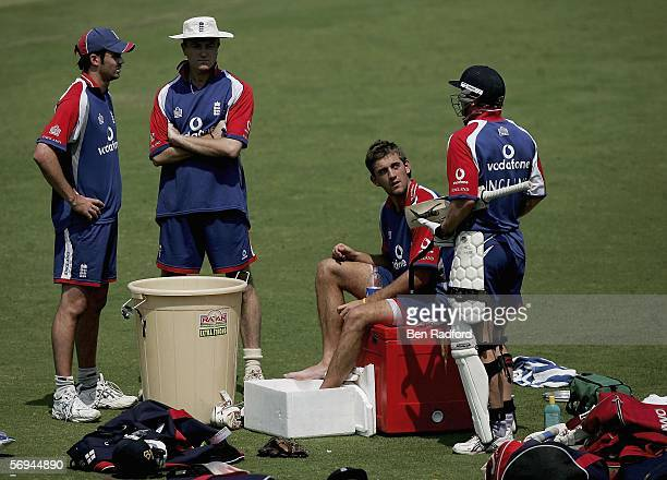 Liam Plunkett of England chats to Ian Bell Shaun Udal and Jimmy Anderson as he rests his left ankle in an ice bath during England's first net...