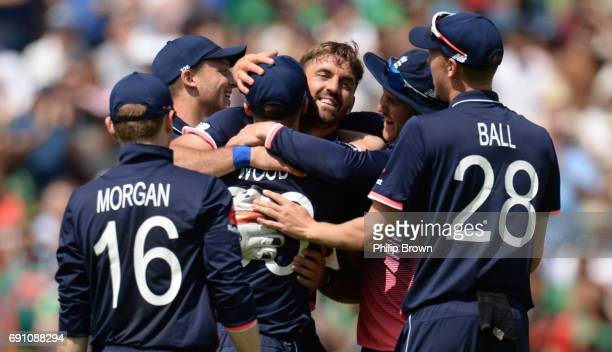 Liam Plunkett of England is congratulated after dismissing Imral Kayes during the ICC Champions Trophy match between England and Bangladesh at the...