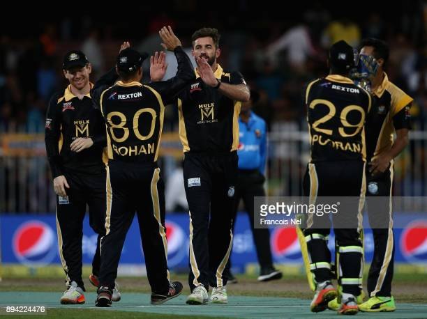 Liam Plunkett of Kerela Kings celebrates with team mates after dismissing Ross Whiteley of Maratha Arabians during the T10 League semifinal match...