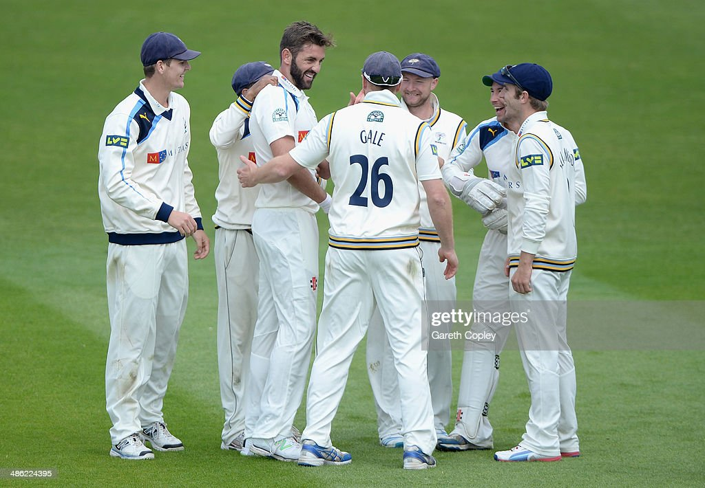 Liam Plunkett of Yorkshire celebrates with teammates after dismissing Andrew Hall of Northamptonshire during day four of the LV County Championship division One match between Yorkshire and Northamptonshire at Headingley on April 23, 2014 in Leeds, England.