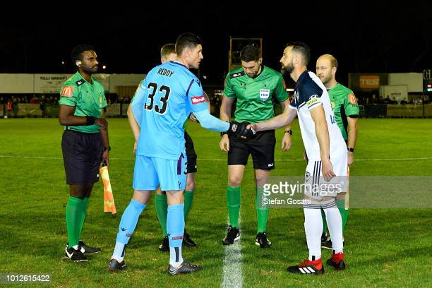 Liam Reddy of the Glory and Carl Valeri of the Victory shake hands following the coin toss during the FFA Cup round of 32 match between Perth Glory...