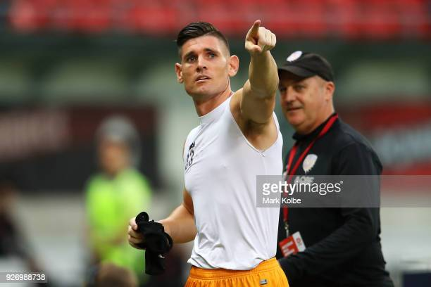 Liam Reddy of the Glory points to the empty Red Black Bloc section of the crowd after he was sent off during the round 23 ALeague match between the...
